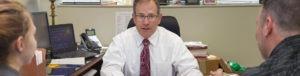 Attorney Dick Freeburn Working at Desk