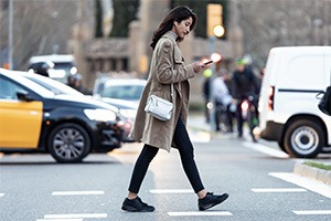 woman-crossing-road-on-cellphone