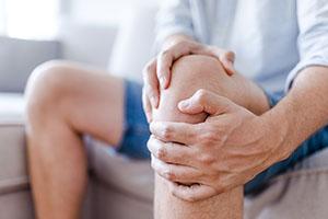 man-massaging-knee-pain